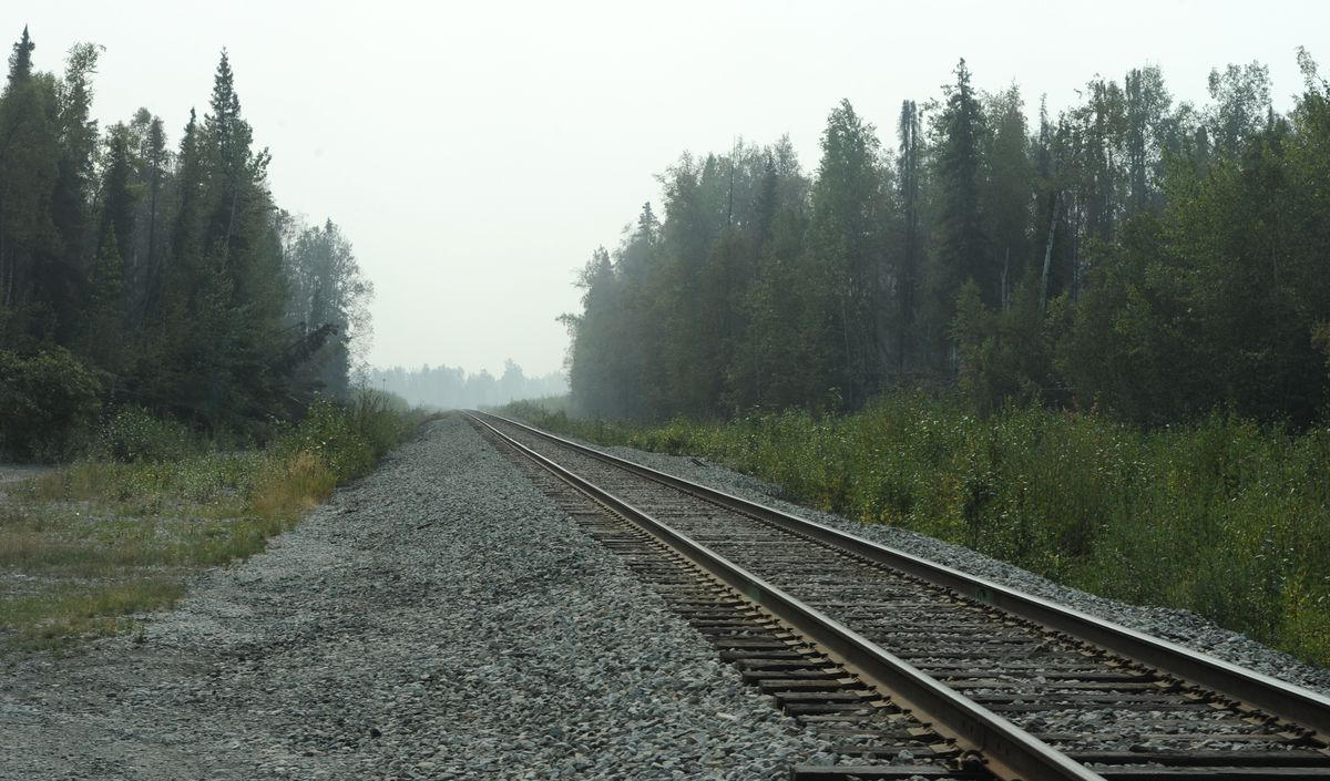 Smoke limited visibility along the Alaska Railroad tracks at East Hidden Hills Road during the McKinley Fire along the Parks Highway on Tuesday, Aug. 20, 2019. (Bill Roth / ADN)