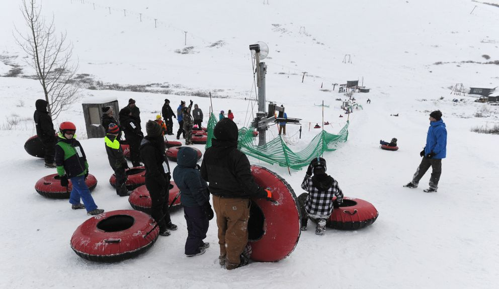 Riders wait to slide down the tube park. (Bill Roth / ADN)