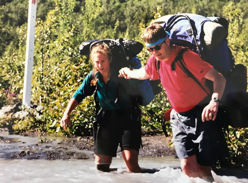 Kenai psychologist Paul Turner, right, crosses the Eagle River on the Crow Pass trail with Karen Brewer in August 1999. (Courtesy Paul Turner)