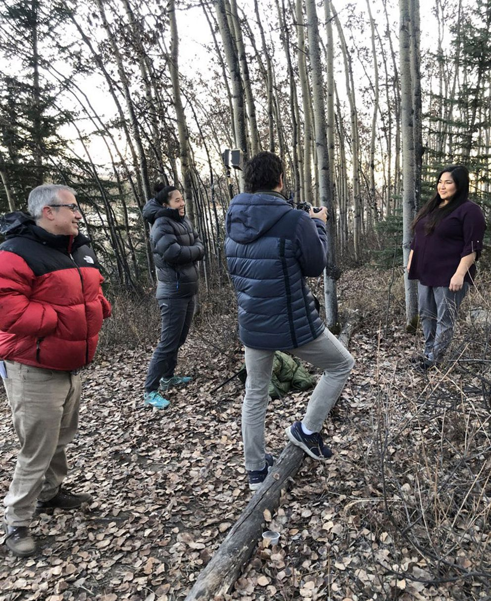Left to right: Kyle Hopkins of the Anchorage Daily News, Agnes Chang of ProPublica, Loren Holmes of the Anchorage Daily News and Jessica Wilson at Chena Ridge in Fairbanks. Holmes was photographing Wilson for the Unheard series. (Adriana Gallardo/ProPublica)