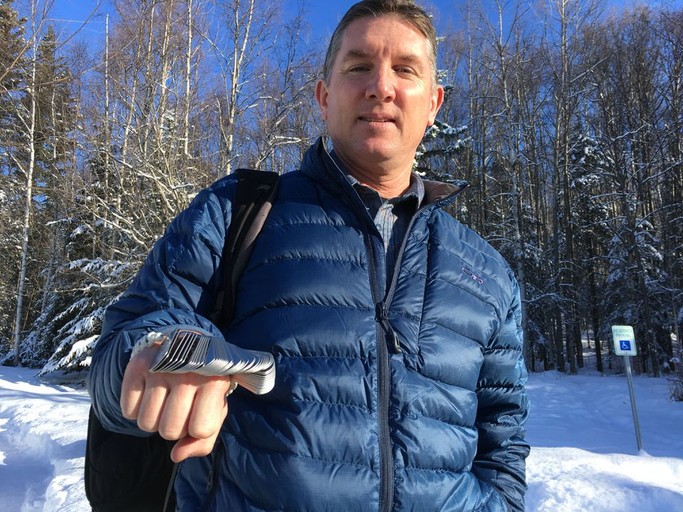 Kirk Alkire is a veteran who has climbed a mountain dozens of times to honor his fallen friends in Iraq. He holds tags of 53 Anchorage-based soldiers killed during a tour during the surge in 2007. (Photo by Charles Wohlforth / ADN)