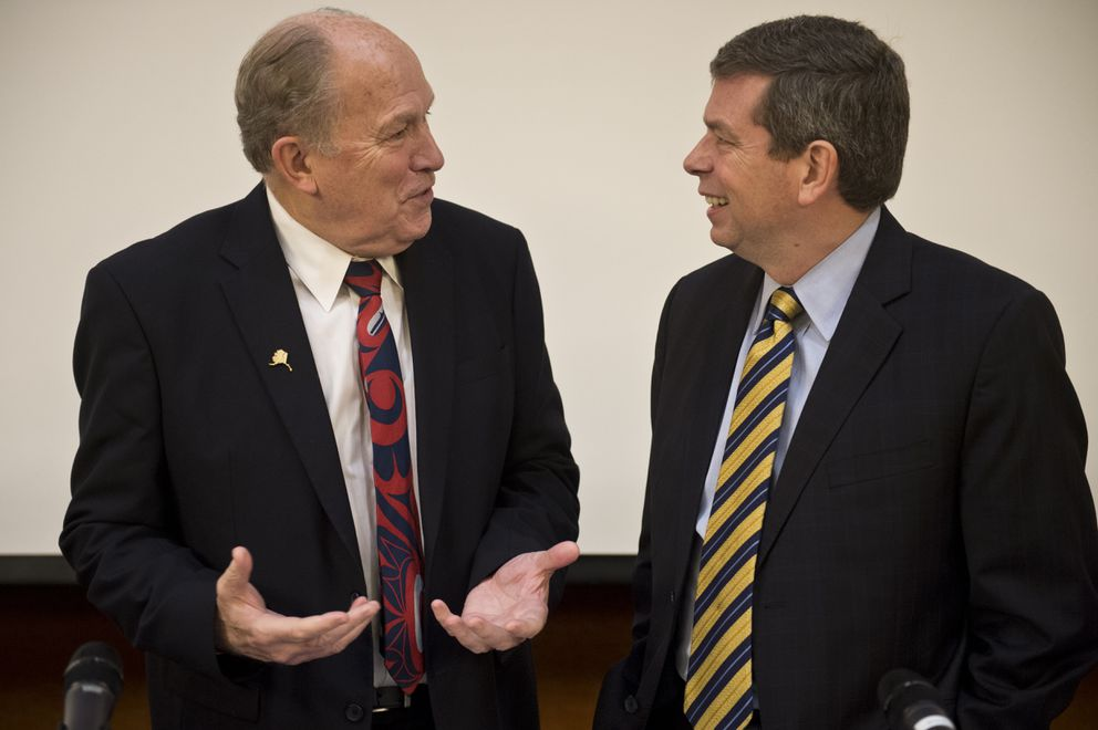 Gov. Bill Walker, left, talks with Mark Begich before the debate begins. . (Marc Lester / ADN)