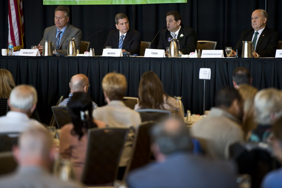 Four candidates for governor participated in a lunchtime forum hosted by the Anchorage Chamber of Commerce at the Dena'ina Center on September 10, 2018. From left are Mike Dunleavy, Mark Begich, Billy Toien and Gov. Bill Walker. (Marc Lester / ADN)