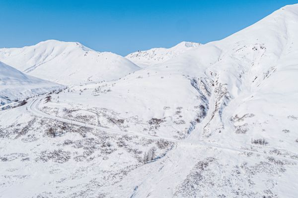 One of several avalanches crosses Hatcher Pass Road on Friday, April 16, 2021. This morning, the Alaska Department of Transportation used a helicopter and explosives to make the area safe for plows to begin work on clearing the road, a process that may take several days, according to DOT spokesperson Shannon McCarthy. (Loren Holmes / ADN)