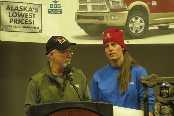 Jeff King and Aliy Zirkle thank the community of Nulato at the Iditarod Banquet Sunday night. The checkpoint village raised money for the mushers after a snowmachiner from the village struck both mushers' dog teams on the trail.