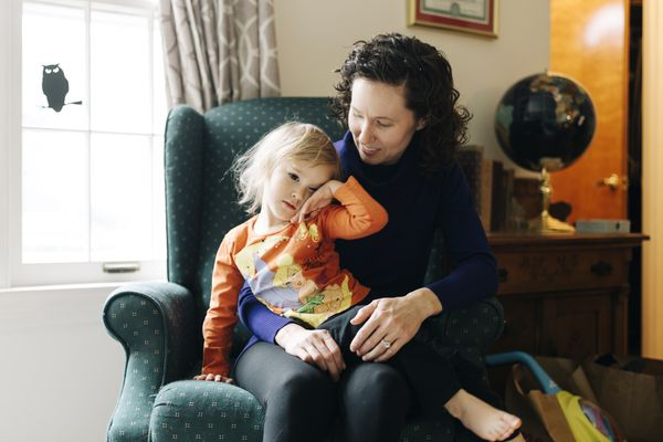Tammy Cooper sits with her 3-year-old daughter, Jillian, at their Parchment, Mich., home. MUST CRECIT: photo for The Washington Post by David Kasnic.