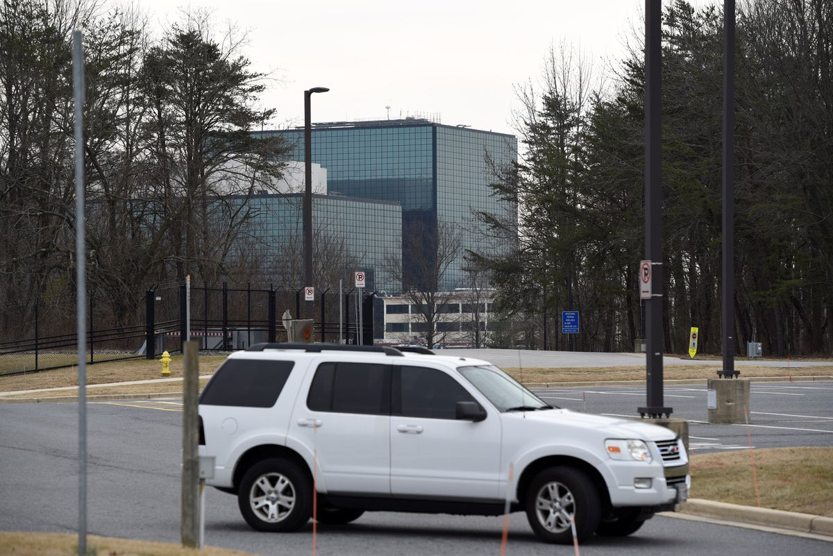 An official vehicle is parked at the media staging area Wednesday after a shooting outside the National Security Agency headquarters, seen in the background, in Fort Meade, Maryland. REUTERS/Sait Serkan Gurbuz