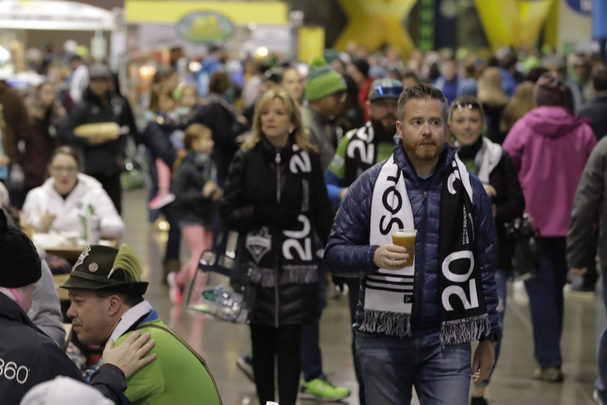 People crowd a concourse area of CenturyLink Field prior to an MLS soccer match between the Seattle Sounders and the Chicago Fire, Sunday, March 1, 2020, in Seattle. (AP Photo/Ted S. Warren)