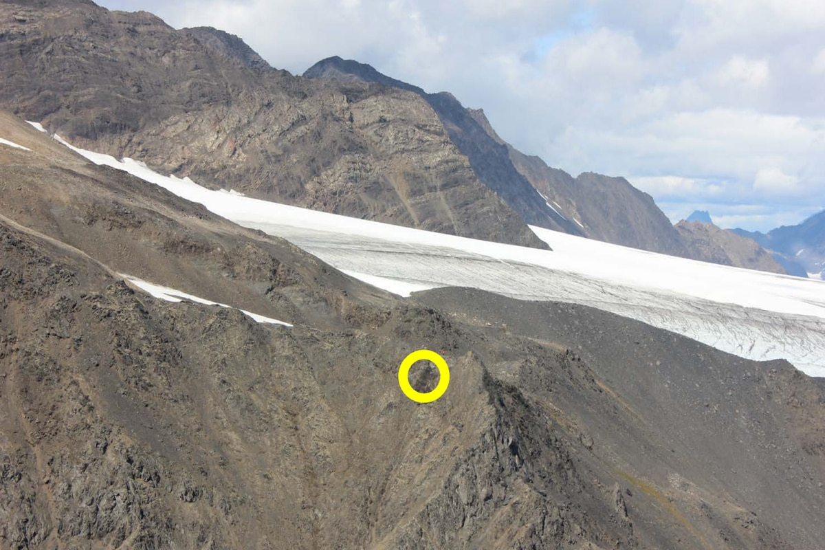 Impact point (circled) on rock face near ridge line on south face of Goat Mountain near Girdwood where a small plane crashed Aug. 4, 2019. (NTSB photo)