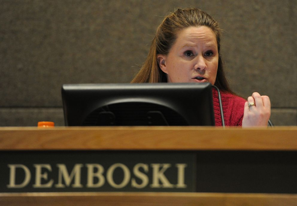 Assemblywoman Amy Demboski speaks directly to Gregory and Maleika Jones after they addressed the Anchorage Assembly on Tuesday about comments Demboski made about them. (Bill Roth / Alaska Dispatch News)