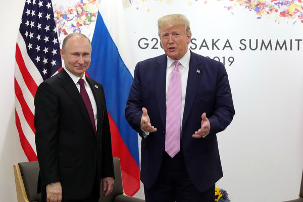 U.S. President Donald Trump, right, and Russian President Vladimir Putin pose for a photo during a bilateral meeting on the sidelines of the G-20 summit in Osaka, Japan, Friday, June 28, 2019. (Mikhail Klimentyev, Sputnik, Kremlin Pool Photo via AP)