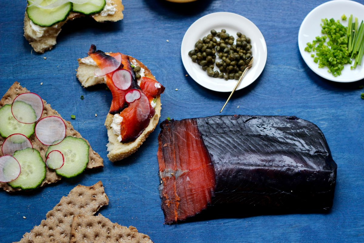 Red salmon, cured with wild Alaska blueberries, makes for a striking twist on classic smoked salmon. (Kim Sunée)