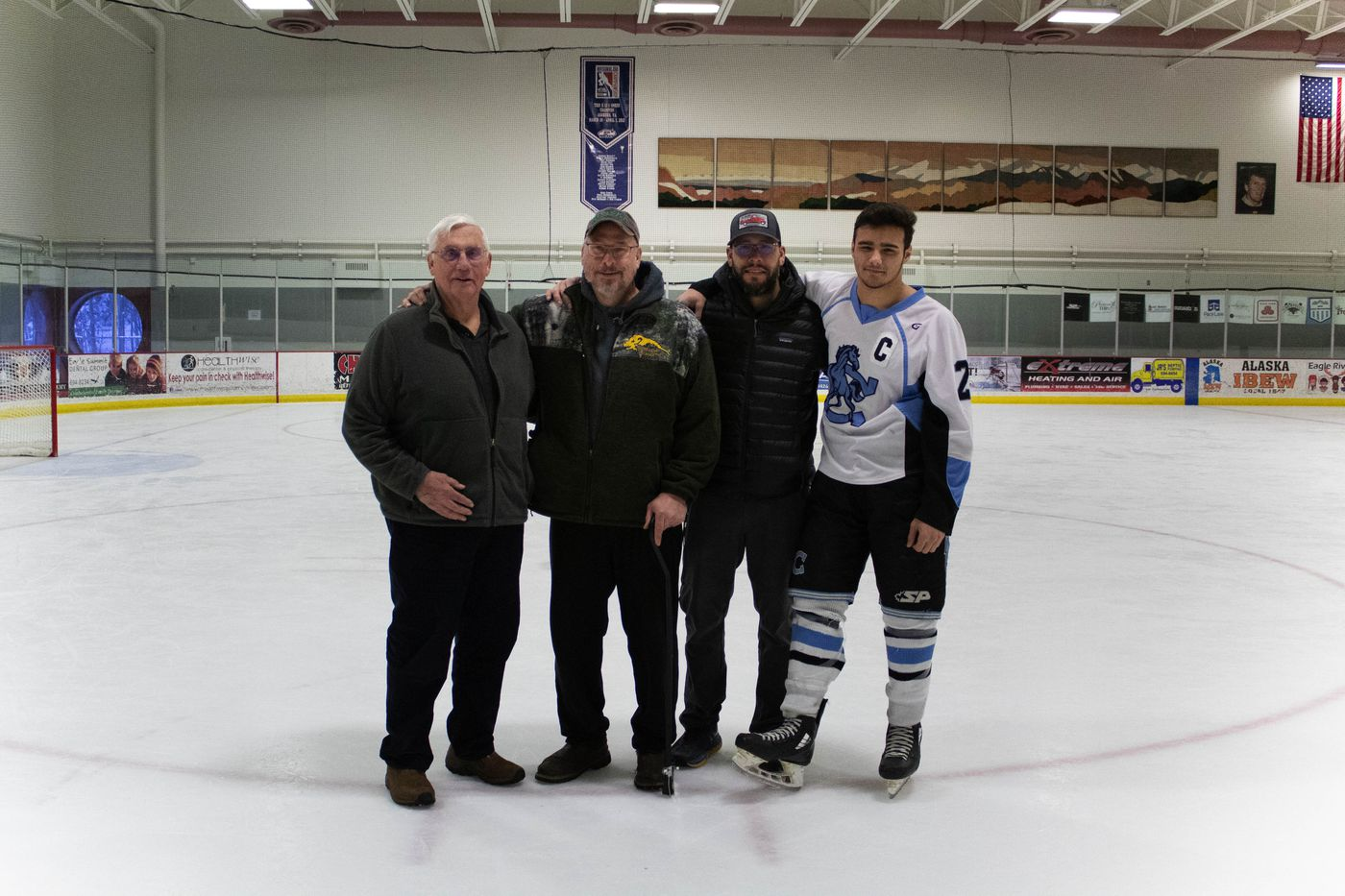 Three generations of the Huffer family who have all been involved in ASAA pose at the ice rink, including Tom Sr., brothers Tom Jr. and John Paul and John Paul's son, Tyler. (ASAA)