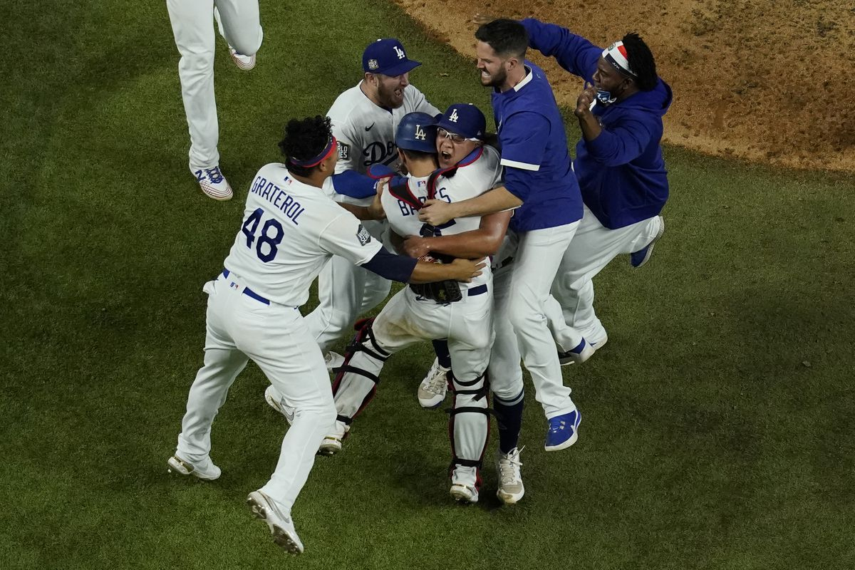 Los Angeles Dodgers celebrate after defeating the Tampa Bay Rays 3-1 to win the baseball World Series in Game 6 Tuesday, Oct. 27, 2020, in Arlington, Texas. (AP Photo/David J. Phillip)