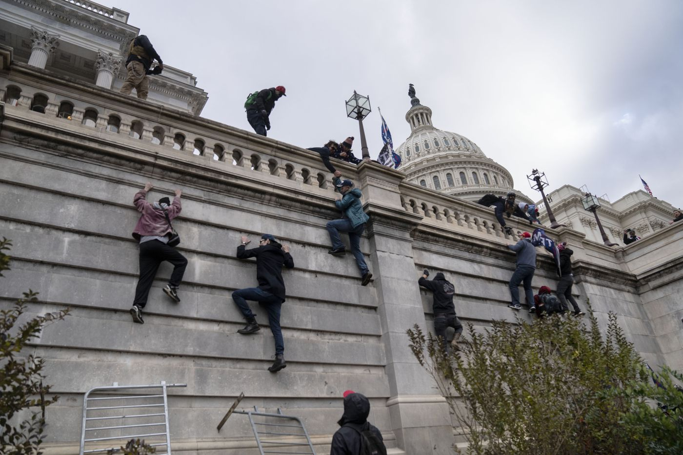 Supporters of President Trump scaled the walls on the Senate side of the US Capitol and gained access inside the building during a massive protest in Washington on Jan. 6, 2021. Washington Post photo by Michael Robinson Chavez.