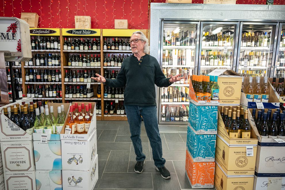 Salesman Dan Piper stocks product at the Wine House on Minnesota Boulevard on Thursday, March 19, 2020. (Loren Holmes / ADN)