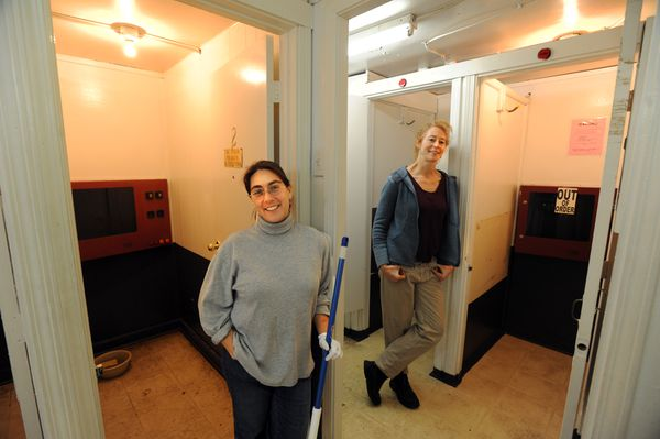 Two of four Writer's Block Bookstore and Cafe owners, Vered Mares, left, and Kathy McCue, pause from cleaning booths in the former Adults Only shop in December  2015.  (Erik Hill / ADN)