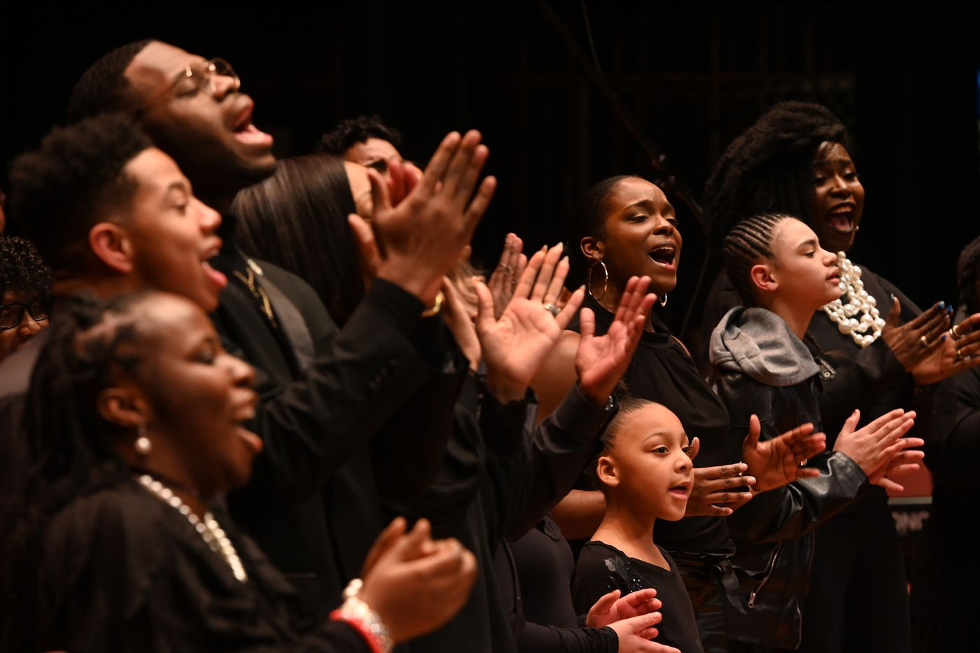 JANUARY 19. The MLK Community-Wide Choir performed during the annual Martin Luther King, Jr. Holiday Commemoration at the West High School Auditorium. (Bill Roth / ADN)