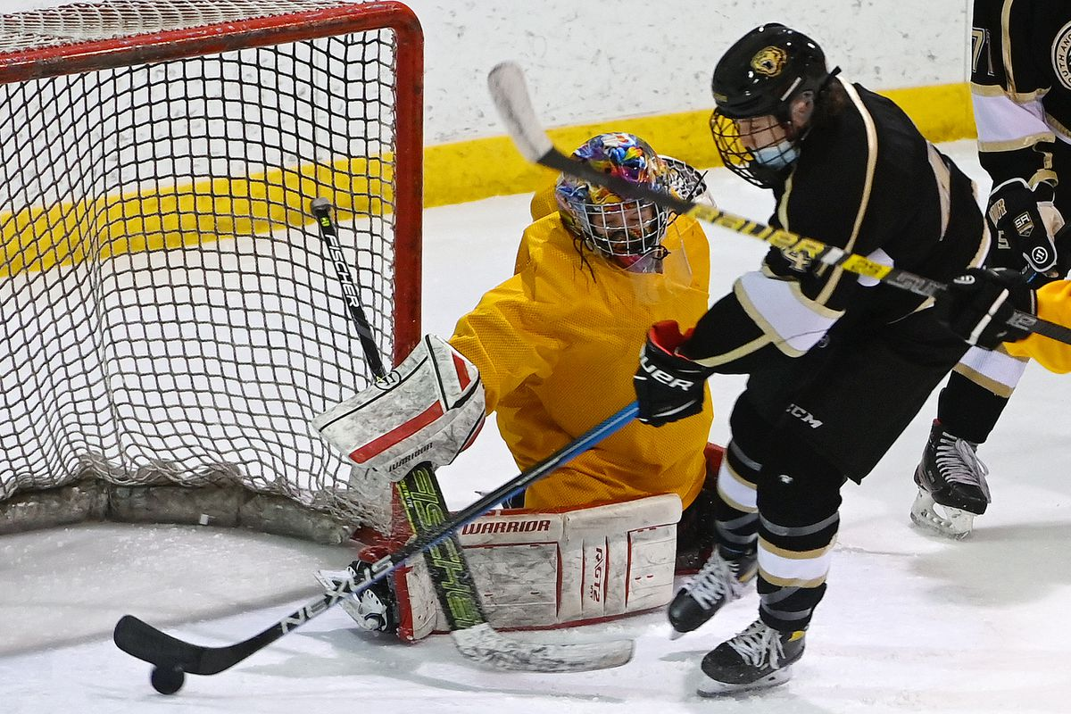 South Anchorage forward Bryce Bethard slips the puck past Bartlett goalie River Scott during the Wolverines' 13-1 victory over the Golden Bears at Ben Boeke on Tuesday. (Bill Roth / ADN)