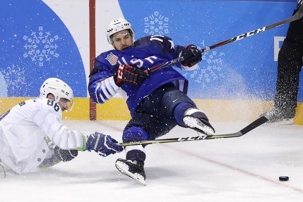 Ice Hockey – Pyeongchang 2018 Winter Olympics – Men's Preliminary Round Match – U.S. v Slovenia - Kwandong Hockey Centre, Gangneung, South Korea – February 14, 2018 - Slovenia's Sabahudin Kovacevic and Garrett Roe of Team USA. REUTERS/David W Cerny TPX IMAGES OF THE DAY