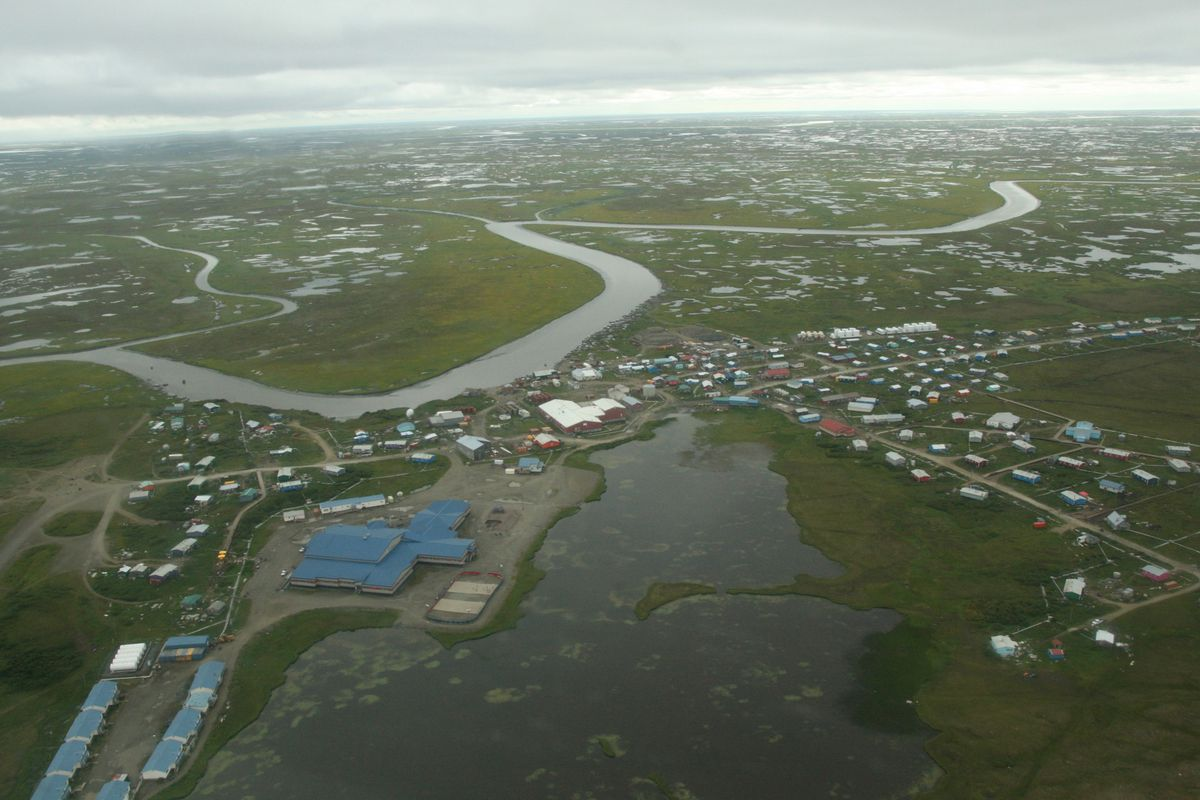 The Southwest Alaska village of Chevak is seen from the air on Aug. 11, 2016. Some Yukon-Kuskokwim Delta communities are already in some form of a lockdown, including Chevak, where the state has so far reported nearly 300 cases — about a third of the total population. (Lisa Demer / ADN)