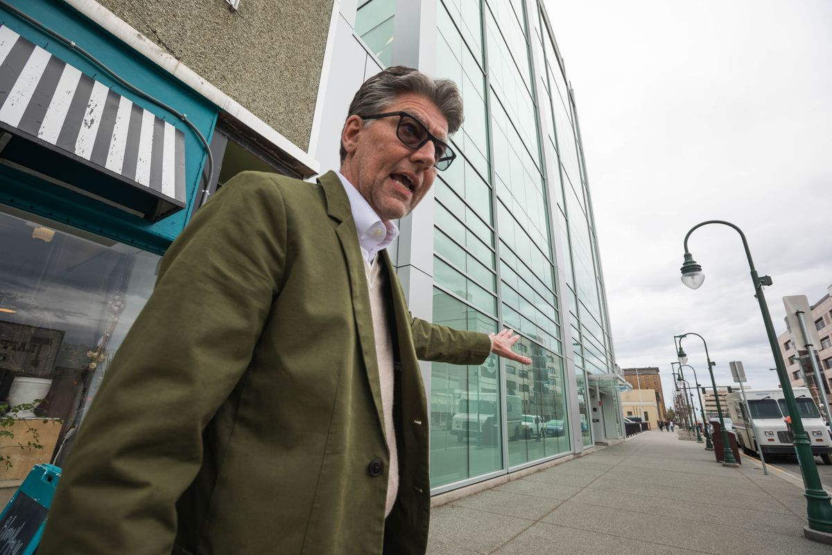 Andrew Halcro, executive director of the Anchorage Community Development Authority, speaks to reporters outside the former Legislative Information Office in downtown Anchorage on Wednesday.  (Loren Holmes / ADN)