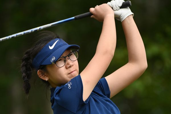 Elizabeth Kim, 17, of Fairbanks watches a tee shot en route to winning the Women's State Am golf tournament at the Anchorage Golf Course on Sunday, July 12, 2020. (Bill Roth / ADN)