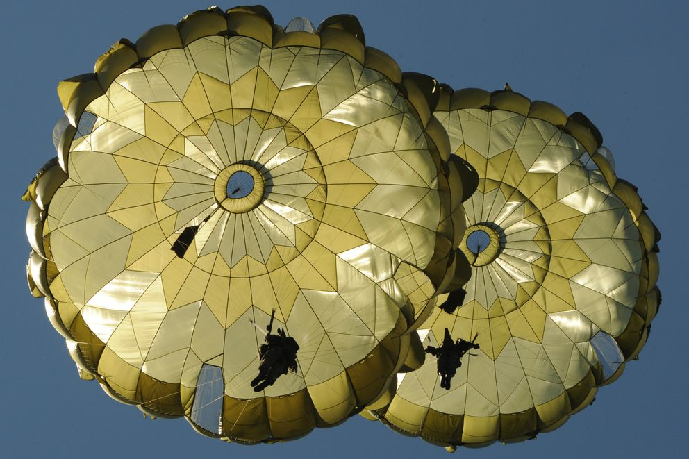 U S  Army Alaska and Japanese paratroopers jump together on