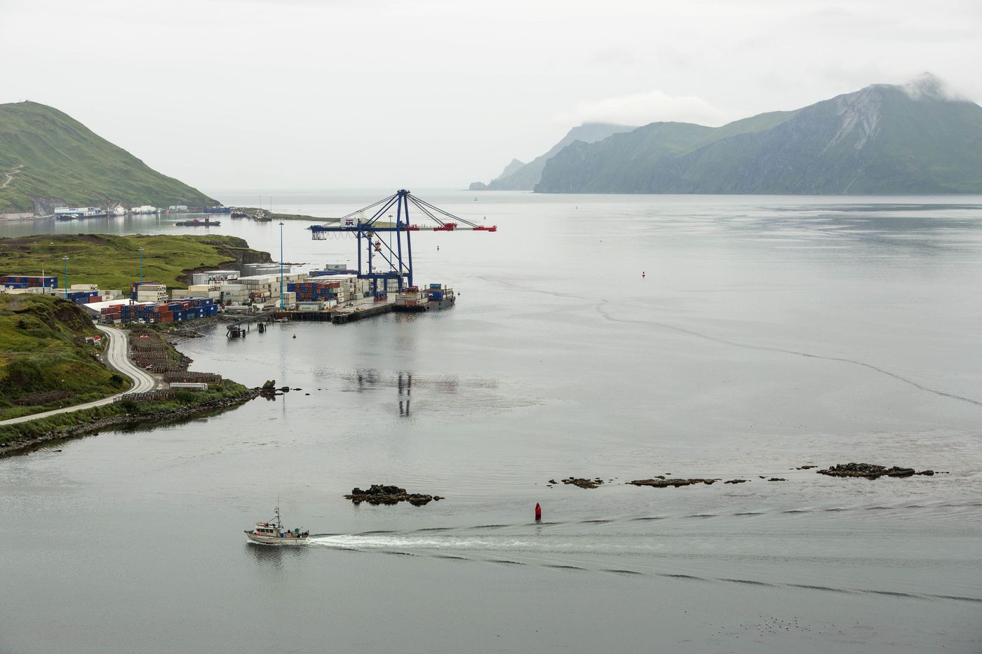 A fishing boat returns to harbor in Unalaska, Alaska on August 31, 2012. The city's port of Dutch Harbor is the largest fisheries port in the U.S., and is positioned to become a major trans-shipment port as Arctic Ocean shipping routes open up.