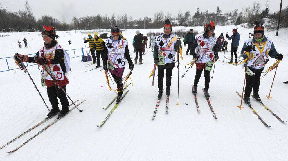Five crowned queens ski during the costume judging at the 23rd annual Alaska Ski for Women at Kincaid Park on Sunday, Feb. 3, 2019. (Bill Roth / ADN)