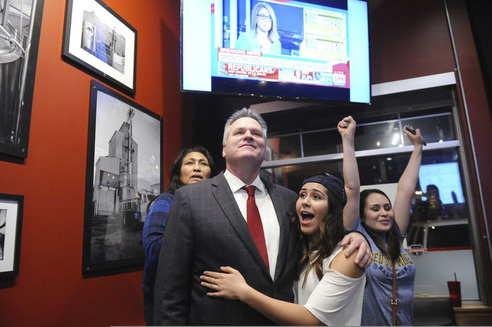 Republican gubernatorial candidate Mike Dunleavy reacts to early favorable election returns Tuesday, Nov. 6, 2018 In Anchorage, Alaska. WIth Dunleavy are from left, his wife Rose and daughters Ceil and Maggie. (AP Photo/Michael Dinneen)