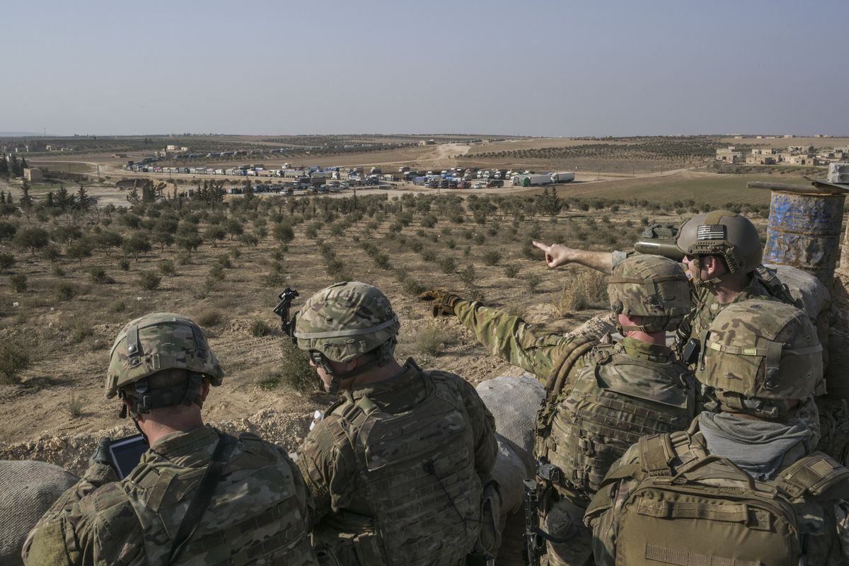 U.S. Special Forces soldiers at a front line outpost outside Manbij, Syria, Feb. 7, 2018. Four Russian nationals, and perhaps dozens more, were killed in fighting between pro-government forces in eastern Syria and members of the U.S.-led coalition fighting the Islamic State, according to Russian and Syrian officials. A Syrian military officer said that about 100 Russian soldiers had been killed in the fighting on Feb. 7 and 8. (Mauricio Lima/The New York Times)