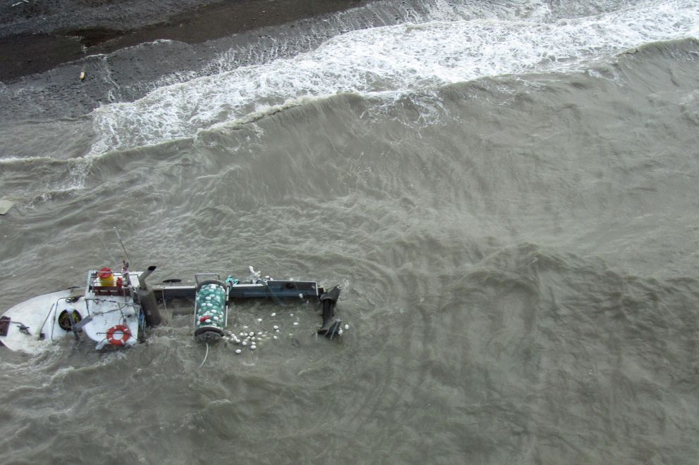The vessel Ketok is partially submerged off Ekuk Beach in Nushagak Bay on Monday. At least four vessels were partially submerged in the bay Monday after encountering bad weather in the region. (Tim Sands / Alaska Department of Fish and Game)