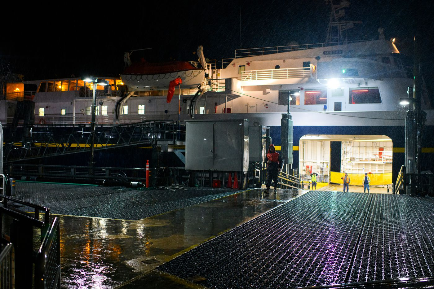 Alaska Marine Highway employees prepare to load vehicles and passengers on Aurora before a 5 a.m. departure from Cordova on September 18, 2019. (Marc Lester / ADN)