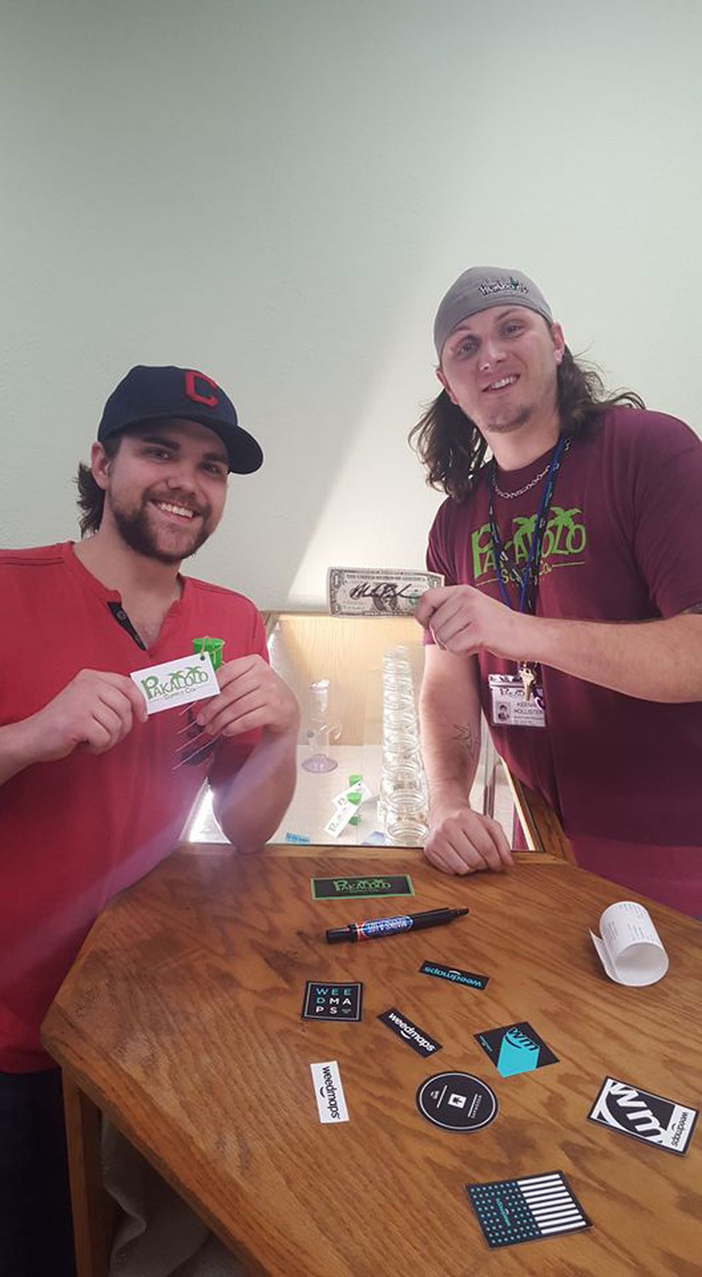 Mike Pokrivnak, left, and co-owner of Pakalolo Supply Co. Keenan Hollister pose after Pokrivnak makes the first legal cannabis purchase in Alaska. (Pakalolo Supply Co.)