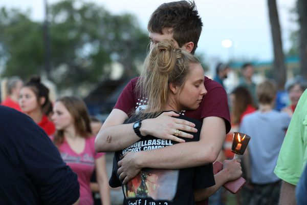 Students embrace during a vigil held at the Texas First Bank after a shooting left several people dead at Santa Fe High School in Santa Fe, Texas, U.S., May 18, 2018. REUTERS/Trish Badger