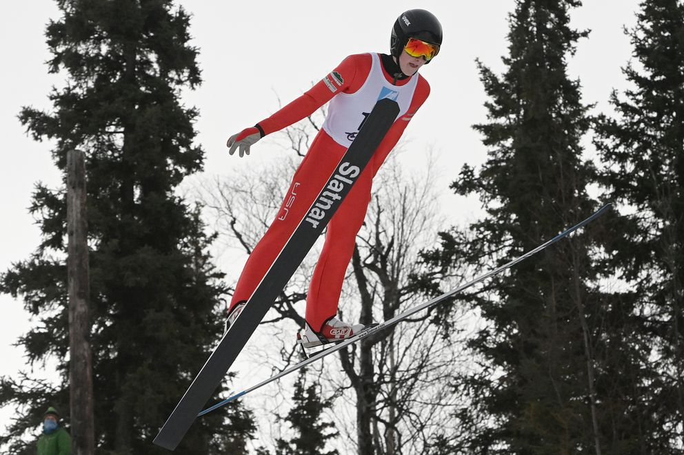 Skyler Amy flies through the air after launching off the 65-meter jump. (Bill Roth / ADN)