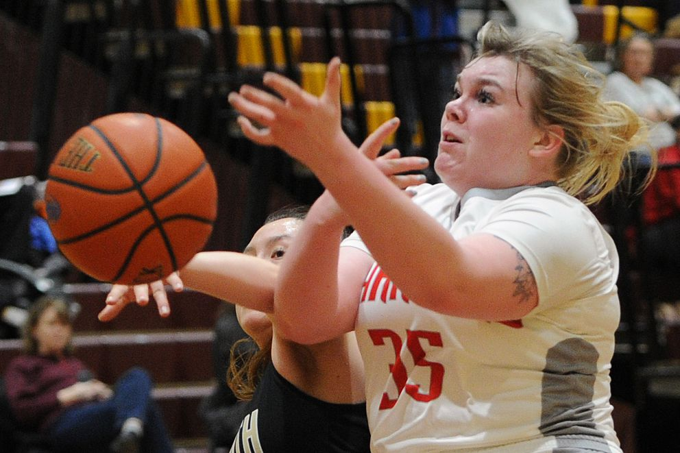 South junior Jo Kashevarof knocks the ball away from Wasilla senior Cheyenne Green as she drives to the basket during the Warriors' 71-37 victory. (Bill Roth / ADN)