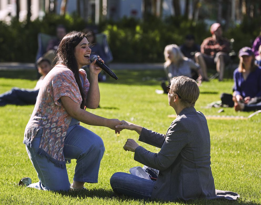 Molly Dieni walks into the audience and holds the hand of Spenard Jazz Fest Director, Yngvil Vatn Guttu, while performing Friday. (Emily Mesner / ADN)