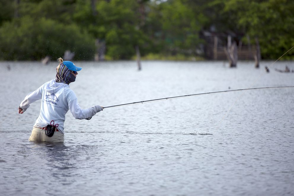 In a handout photo, fly fishing guide Kate Taylor in Honduras, 2014. Women are the fastest growing demographic in fly fishing, one of the most male-dominated outdoor sports. (Andrews Burr/Patagonia via The New York Times)