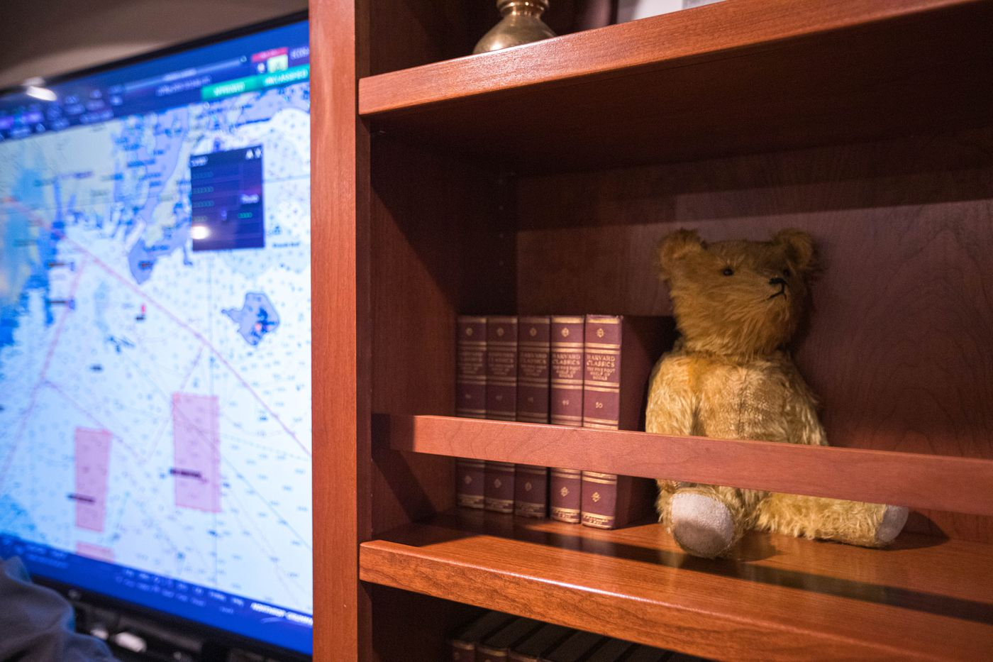 A teddy bear sits in the commanding officer's in-port cabin aboard the USS Theodore Roosevelt on Wednesday. The Nimitz-class aircraft carrier is named for America's 26th president, as are the stuffed bear toys. (Loren Holmes / ADN)