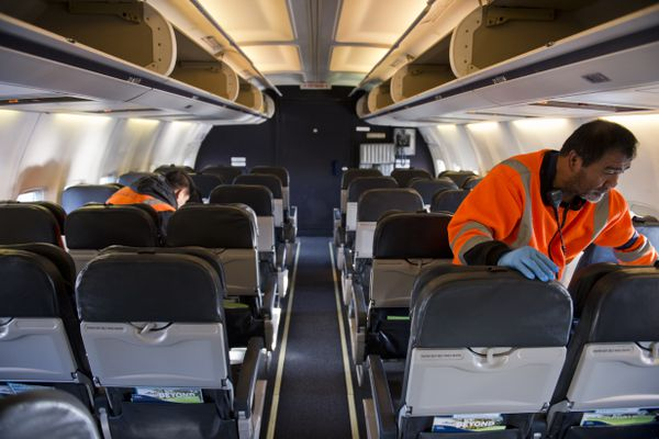 Ayld Fermantez, left, and Pedrito Suniga service the cabin of the 737-400 Combi aircraft. The final flight of an Alaska Airlines Boeing 737-400 Combi aircraft departed Anchorage on Oct. 18, 2017. Alaska Airlines operated five of the jets, which were configured to carry freight in the front and passengers in the rear. The company is transitioning to dedicated cargo aircraft in Alaska. (Marc Lester / Alaska Dispatch News)
