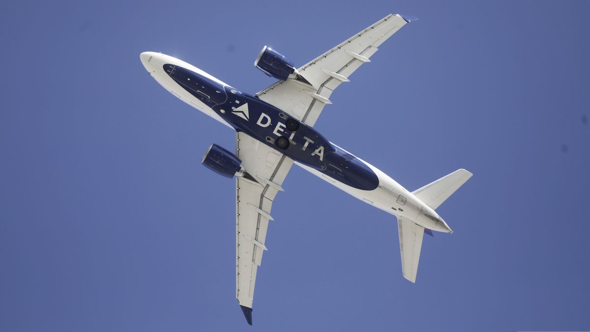 In this Tuesday, April 7, 2020, file photo, Delta flight is shown taking off from Salt Lake City International Airport, in Salt Lake City. Treasury Secretary Steven Mnuchin said Tuesday, April 14, 2020, that the nation's major airlines have tentatively agreed to terms for $25 billion in federal aid to pay workers and keep them employed through September. (AP Photo/Rick Bowmer, File)