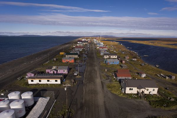 FILE — The ocean to the left, and a river on the right of Shaktoolik, Alaska, Sept. 17, 2016. Shaktoolik is one of 31 towns and cities in Alaska that may need to relocate because protective sea ice is vanishing, leaving shorelines exposed to erosion by fierce waves. (Josh Haner/The New York Times)