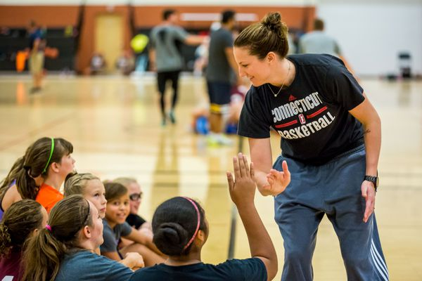 LOREN HOLMES / Alaska Dispatch News Former Chugiak student Kelsey Griffin cheers on girls at the AT&T Sports Center in Palmer on Saturday, August 30, 2014. Griffin now plays professional basketball in the WNBA, and was on hand for a day camp organized by the Alaska Lady Hoops.