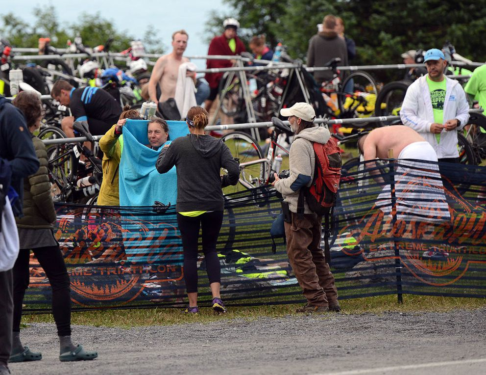 Competitors transition from swimming to cycling in Seward. (Photo by Erik Hill)