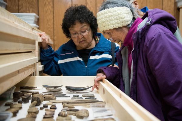 Annie Wassilie and Pauline Beebe are among the first to enter the Nunalleq Culture and Archaeology Center in Quinhagak on Aug. 11. (Katie Basile / KYUK)