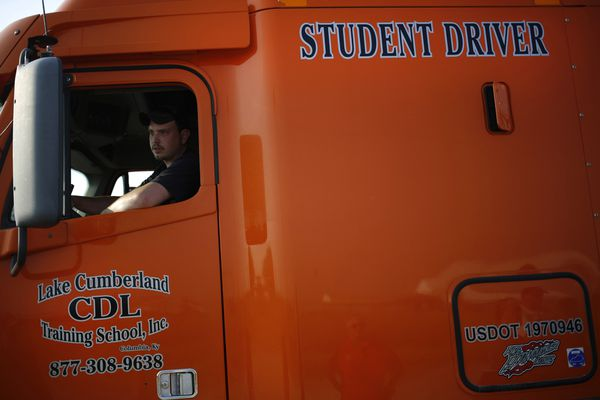 A student practices hooking an 18-wheeler up to a trailer during a commercial drivers license class at Lake Cumberland CDL Training School in Mt. Sterling, Ky. Bloomberg photo by Luke Sharrett