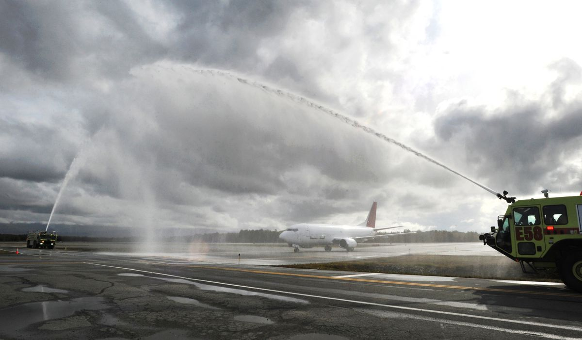 Retiring Northern Air Cargo pilot Wally Niles of Wasilla received a water cannon salute Tuesday, Sept. 10, 2019, while taxiing a Boeing 737-300 to the ramp at Ted Stevens Anchorage International Airport after a flight from King Salmon. (Bill Roth / ADN)