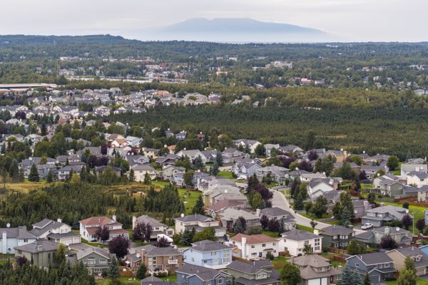 Mount Susitna rises behind homes in Anchorage's Bayshore neighborhood Thursday, Aug. 31, 2017. (Loren Holmes / Alaska Dispatch News)
